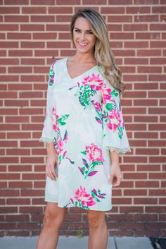 Local's Luau Dress, Green || This fun floral dress is absolutely precious! The mix of bright and soft colors is gorgeous! Plus, it has crochet around the sleeves and the cut outs in the back! This dress is going to be a tough act to follow!