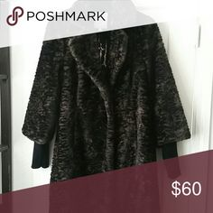 Coat Beautiful faux fur, brown with black pattern,hook closure and sweater cuffs , rich collar and lapels Tracy Reese Jackets & Coats Pea Coats