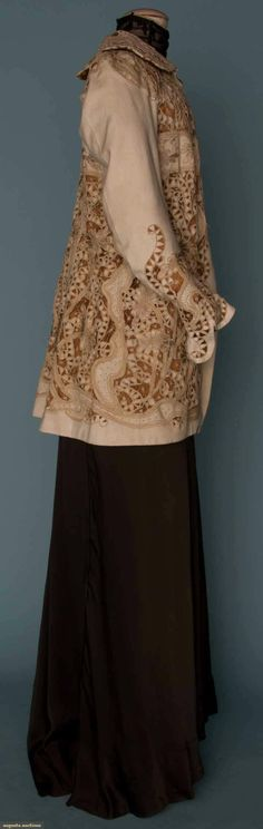 EMBROIDERED WHITE WOOL JACKET, c. 1908. Empire w/ cutwork & embroidery in serpentine & floral pattern, lavishly embroidered flowers, scalloped collar, cocoa brown silk lining. Sideway