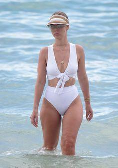 Swimsuit designer Bianca Elouise flaunts her shapely ...