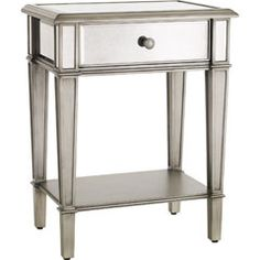 As glamorous as its movie-star namesake, yet as practical as we can make it - our Hayworth Nightstand is all about functional fashion. This must-have for the bedroom is handcrafted, hand-painted and covered with hand-cut beveled mirrors. A single storage drawer holds the remote while a lower storage shelf keeps books and magazines out of the way. A Pier 1 Imports exclusive.