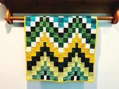 Handmade baby quilts are one of the best gifts you can give as a baby shower gift. Sew Happy Quilting has unique quilts for baby girls and baby boys. Baby quilts are washable and are wonderful heirloom gifts that can be passed from generation to generation. Check out sewhappyquilting.com today. #babyquilt #babygirlquilt #babyboyquilt #babyshowergift #uniquebabygift #heirloomgift #babyblanket #nurserydecor #cribquilt Bargello Quilt Patterns, Unique Baby Gifts, Handmade Gifts, Fabric Coasters, Handmade Baby Quilts, Baby Girl Quilts, Quilts For Sale, Quilted Wall Hangings, Receiving Blankets