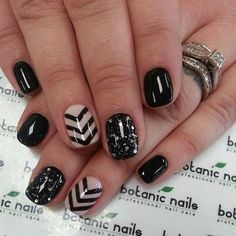Off white as the base and then create some V-shaped patterns in black for a sophisticated look. Plus those rhinestones on black nail lacquer just shouts glamour.