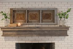 Joanna+repainted+the+brick+fireplace+and+added+this+wood+mantel+and+rustic+carved+wall-hanging.