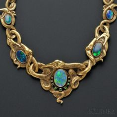 This stunning neclace sold at Skinner's in Art Nouveau offerings proved to be in high demand, with an intriguing, serpentine Art Nouveau Gold, Opal, and Demantoid Garnet Necklace from theCollection of Rita Goodman s Snake Jewelry, Gems Jewelry, Jewelry Art, Antique Jewelry, Vintage Jewelry, Fine Jewelry, Jewelry Design, Silverware Jewelry, Bijoux Art Deco