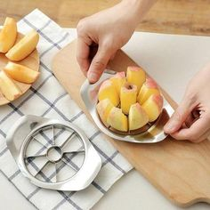 The Stainless Steel Apple Cutter Slicer makes it easy to core and slice apples, tomatoes, and other fruits and vegetables into eight, equal parts, while leaving the center cut out separately from the rest. Apple Slicer, Vegetable Slicer, Watermelon Slices, Soft Foods, Apple Pear, Kitchen Gadgets, Kitchen Stuff, Kitchen Hacks, Cooking