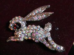 'Rabbit brooch with a ruby eye and crystals all around' is going up for auction at  8am Sun, Jun 9 with a starting bid of $6.