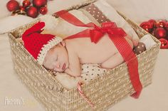 Newborn Christmas Photography- oh my gosh! If she comes for Christmas I have to put her in a box! Lol too cute!