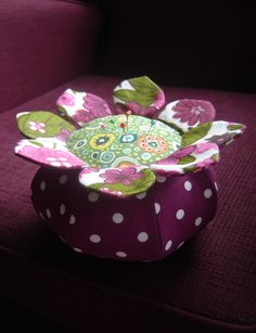 https://flic.kr/p/4Ue1Sn | flower pincushion | pincushion made with Anna Maria Horner pattern. Using vintage fabric and kaffe fassett fabric.