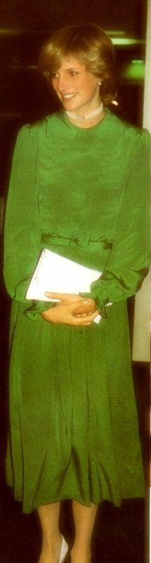 30 April 1983: Departure from Auckland, NZ for Eleuthera. Single narrow-belted dress in emerald-green chiffon. Plain neckline and long sleeves ruffled at the cuff.