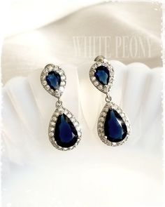Something blue for your special day!!  Art Deco - The Great Gatsby - Downton Abbey inspired small sapphire crystal drop earrings : CAREY blue by ©White Peony by KC.   Beautiful and very sparkling dangle drop wedding earrings are made of AAA quality Sapphire blue Cubic Zirconia (zircon, CZ) teardrop and pave Zirconia in white gold plated alloy settings. ***Please note that product colors in photos may appear slightly different on various computer monitors/smart phones/tablets. Contact my…