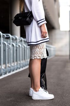 The Fashion Fraction || Does The World Need Fashion Blogs? Chanel classic bag with silver hardware, Nike sneakers, lace skirt, sweater, sporty chic, spring look.