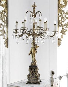 Craig Smith makes and sells candelabra such as this one out of old lamp parts. Find the Smiths' work at their store, Cottage Gardens, in Elizabethtown, Ky., and at the Marburger Antique Show in Texas the first weekend in October.   - CountryLiving.com