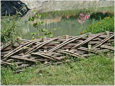 rustic fences images | rustic fence short woven fence for the flower bed around an artificial ...