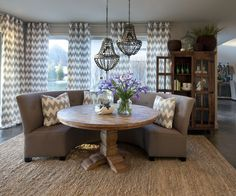Dining Room | Round Reclaimed Wood Pedestal Table , Gray Upholstered Banquet Bench , Gray Chevron Drapery Panels + Pillows