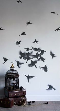 Creative Wall Paint with Movement.... these are painted birds on the wall..great idea for on top of a ombre pallet board wall mimicking dark sky colors.