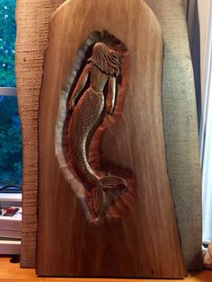 Mermaid in walnut slab, hand-carved by Elizabeth Brown, Liverpool,NS