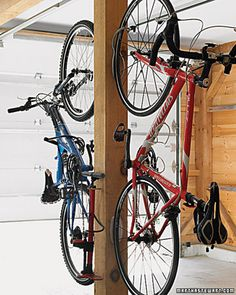 Ride On  This central support post not only holds up the garage, but it also handles two bicycles, thanks to the hefty steel hooks we mounted to both sides. If there isn't a free post in your garage, you could consider ceiling-mount hooks.