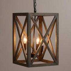 Crafted of gray-washed mango wood, our exclusive chandelier adds a dramatic architectural element to the dining or living room. The black iron chandelier houses four candelabra bulbs, sending light through the open frame.