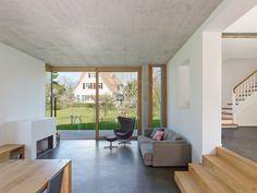Holzer Architekten adds black extension to 1920s house in Stuttgart
