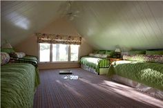 What to do with a pitched, attic space? Turn it into sleepover central for the kids! From designer Michael Abrams.