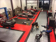 Red, alloy and black RaceDeck Diamond flooring in a race car shop. Garage Loft, Garage Shop, Garage Storage, Automotive Shops, Mechanic Garage, Mechanic Shop, Cool Garages, Tyre Shop, Garage Interior