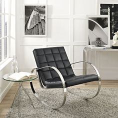 """Gravitas Lounge Chair In Black - EEI-2084-BLK $531  Description :  Eminently steer your decor forward with the Gravitas Lounge Chair. Affixed with streamlined polished steel armrests, and adorned with a plush box-patterned vinyl seat and back, Gravitas makes an impression. Perfect for living and lounge areas, Gravitas is a solidly built lounge chair that exudes progress.  Dimension :  Overall Product Dimensions : 27""""L x 40.5""""W x 32""""H  Floor To Top Of Armrest : 25""""H  Floor To Top Of Seat : 14…"""