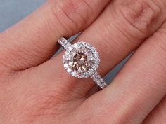 This is our sparkly 1.84 ctw Round Brilliant Cut Diamond Engagement Ring that has a fantastic 1.39 ct Round Cut Natural Chocolate Color/SI1 Clarity, Clarity Enhanced (Fracture Filled) Center Diamond. It looks huge and the custom basket setting is cast in 14K White Gold. It is listed on our website for $4,190.