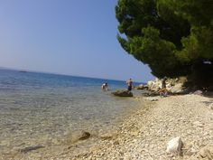 Typical Croatian shore- stone beach. Nice for eyes, not exactly for feet (to those who forgot about special shoes: free peeling guaranteed) ;)