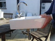 Wall-Mounted-Basin-complete-with-tap-and-waste-and-matching-bath-tap