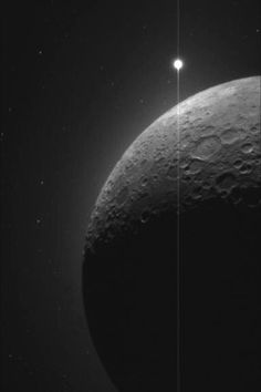 """The Moon and the Morning Star"" -- The moon and Venus as seen by the Clementine probe in 1994; the moon is eclipsing the sun in this photo, resulting in a glow over the horizon."
