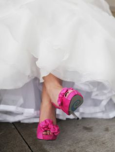 Bride in hot pink shoes #hot #pink #wedding I love it when brides wear colorful shoes!!! Looks awesome in photos :)