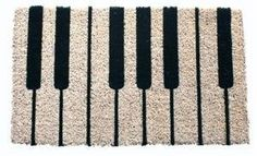 """Piano Coir Doormat by Imports Unlimited. $30.00. 18 in x 30 in.. This mat is hand stenciled with permanent fade-resistant dyes.. Hand made from all-natural coconut fiber which is an excellent dirt-trapper; 3/4"""" thickness. A unique doormat for many settings, this Piano coir mat will tickle your fancy and the ivories! Fun for romantic occasions or as the perfect first step for the music teacher, the mat is hand woven, stenciled and painted in India, these doormats are very durab..."""