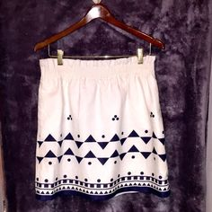 Fun Jcrew skirt White linen with navy blue design! Elastic around the waist so really cute if you wear a shirt tucked in :) not see through which is a huge plus. Worn couple times - still in great condition. No pulls or tears. J. Crew Skirts