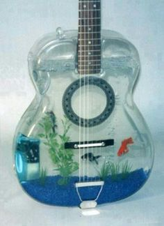 a guitar fish aquarium! Unique Fish Tanks, Cool Fish Tanks, Tropical Fish Tanks, Amazing Fish Tanks, Tropical Aquarium, Aquarium Design, Aquarium Rocks, Tanked Aquariums, Aquarium Fish