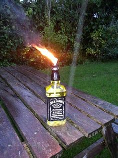 Jack Daniels burner (inspired by tjesse's Glass Bottle Tiki Torch) filled with citronella!!! This could be a great wedding decoration!