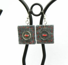Hand-sewn light earrings, unique and comfortable, felt with transparent buttons and a red thread. The felt part is a square of 3 cm. Metal parts are silver-plated  These are second hand buttons that were given a second chance. Although they were upcycled they look like new. The earrings are definitely uncommon and surprising. Its a great idea for those of you who love big earrings, but are afraid of their weight. Theyre very light! They match a grey felt bag or coat, but Im sure theyll look…