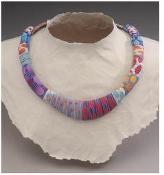 This necklace may look like fiber woven around a metal form or a fabric wrapped piece, but amazingly, it's polymer clay! We're happy to feature the work of Bonnie Bishoff and J.M Syron. They're known for furniture, including wall art, and jewelry. For more of their work and our Inspirational Challenge of the day, stop by The Polymer Arts magazine blog, http://www.thepolymerarts.com/blog/11846