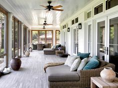 A screened-in porch spans the length of the house and offers breathtaking views of the water.