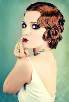 Pin curls, slight Marcelle wave and her make up
