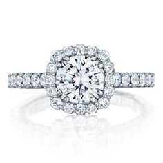 From an aerial view, a cushion shaped halo of blooming round stones decorates the 1.00 carat round center of this French cut style setting. A signature Tacori crescent detail completes the band, adding beauty from every angle. Tacori Style# 37-2CU6.5W