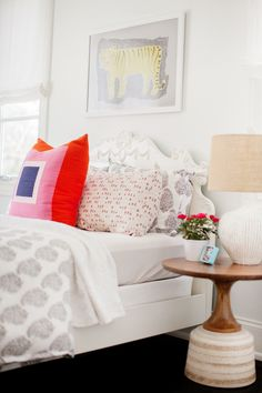White bedroom with pops of color. Design and styling by Pencil & Paper Creative Development Co. Photo: Leslee Mitchell