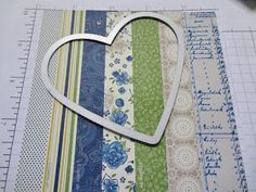 use paper scraps and glue/attach to a backing piece of paper. Then, cut a shape for a card front out of it. (or cut a shape out of a card front with the Cameo, and back the space with your scrap papers.) #scrapbooktips