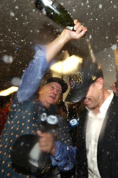 Actor Bill Murray (L) celebrates in the clubhouse with President of Baseball Operations for the Chicago Cubs Theo Epstein after the Cubs defeated the Cleveland Indians 8-7 in Game Seven of the 2016 World Series at Progressive Field on November 2, 2016 in Cleveland, Ohio. The Cubs win their first World Series in 108 years. (Nov. 1, 2016 - Source: Elsa/Getty Images North America)