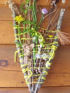 Nature weaving.  My five-year-old was frustrated with wrapping the yarn but thrilled with filling it with treasures.