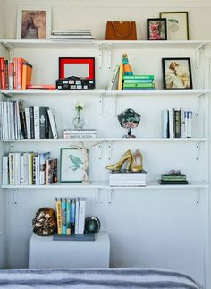 bookshelf - instead of hook use narrow ledges to display vintage purse in bedroom - add in a pair or two of vintage shoes.