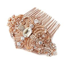 This stunning Vintage Rose Gold Rhinestone Bridal Hair Comb features elegant swirls and leaf accented details on rose gold plating. This magnificent hair accessory will look gorgeous on the side or ba