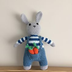 This a pdf pattern to make a fun little bunny in blue jeans.The bunny can be made in lots of colourways.He comes with carrots and a little pocket to store them in too.Made using Paintbox DK cotton yarn each bunny is approximately 27cm tall and 11cm wide.A basic knowledge of crochet is required.
