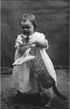poor kitty, ca. 1910. Grownups DO NOT TRY THIS AT HOME! Only a child can get away with this sort of thing!