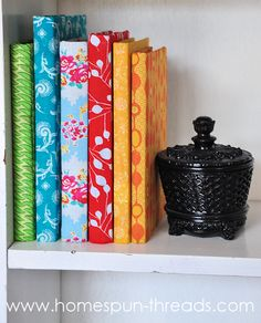 fabric covered books.  Use discarded books.  You can even add fabric name plates to the front and spine if you plan on reading them later.